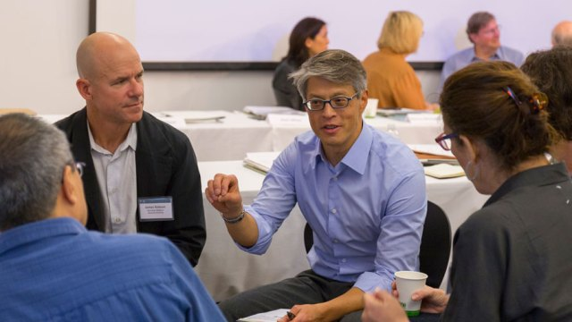 People discussing a topic at a workshop