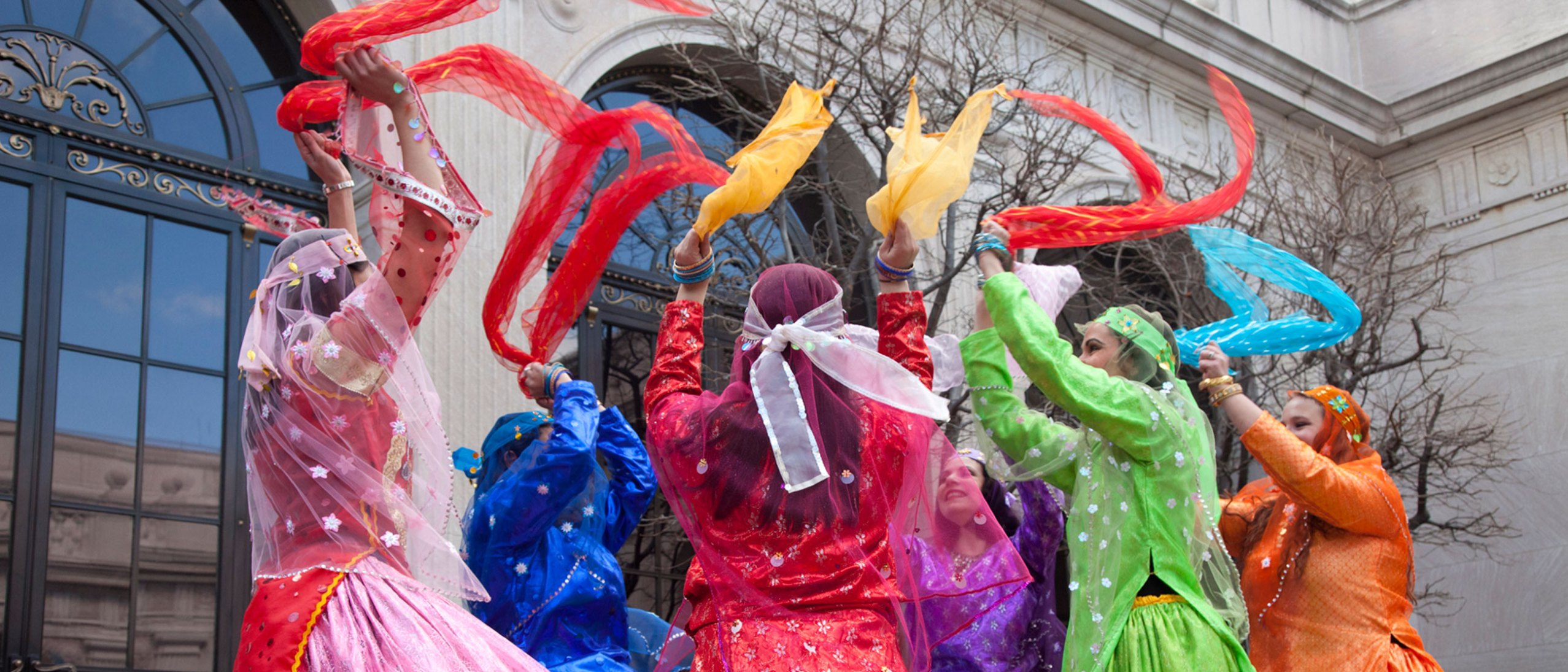 Dancers wave colored scarves at a Freer|Sackler Nowruz celebration.