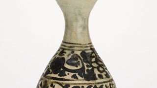 crop of the neck of a decorated stoneware bottle