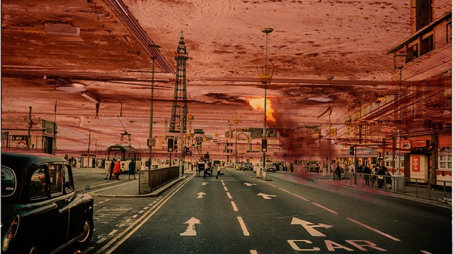 a manipulated street scene, with an ominous red sky in the background and a street with strong perspective lines in the foreground