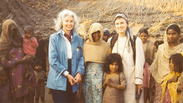 Elizabeth Moynihan and a diverse group of women and girls