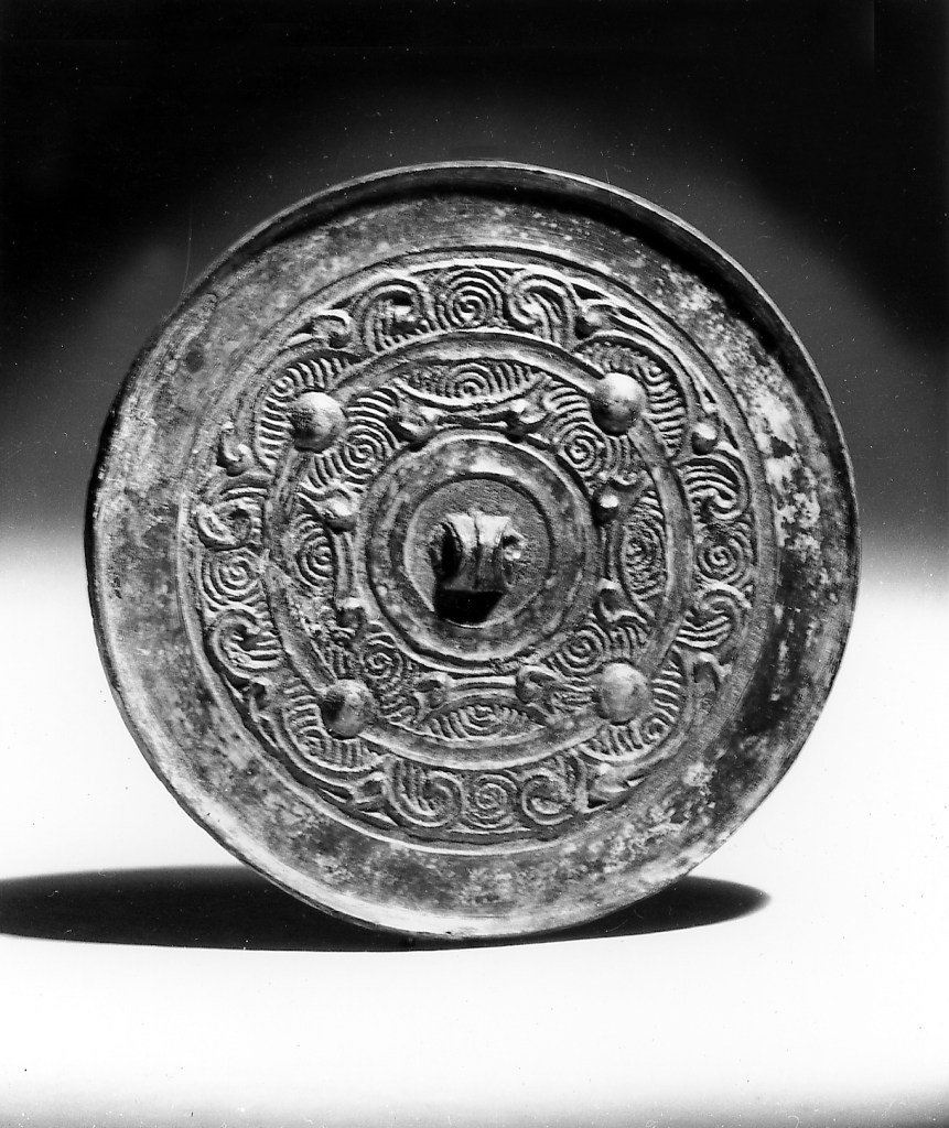 Photo, Bronze mirror. Western Han dynasty, late 2nd–1st century BCE., Diam: 7.2 cm. (2 13/16 in.) Singer catalogue number: [1005].