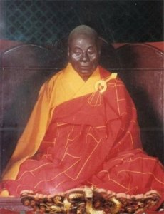 seated mummy in monk's robes