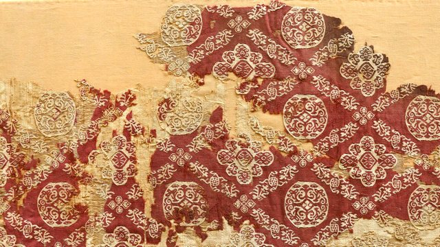 deteriorating textile in crimson