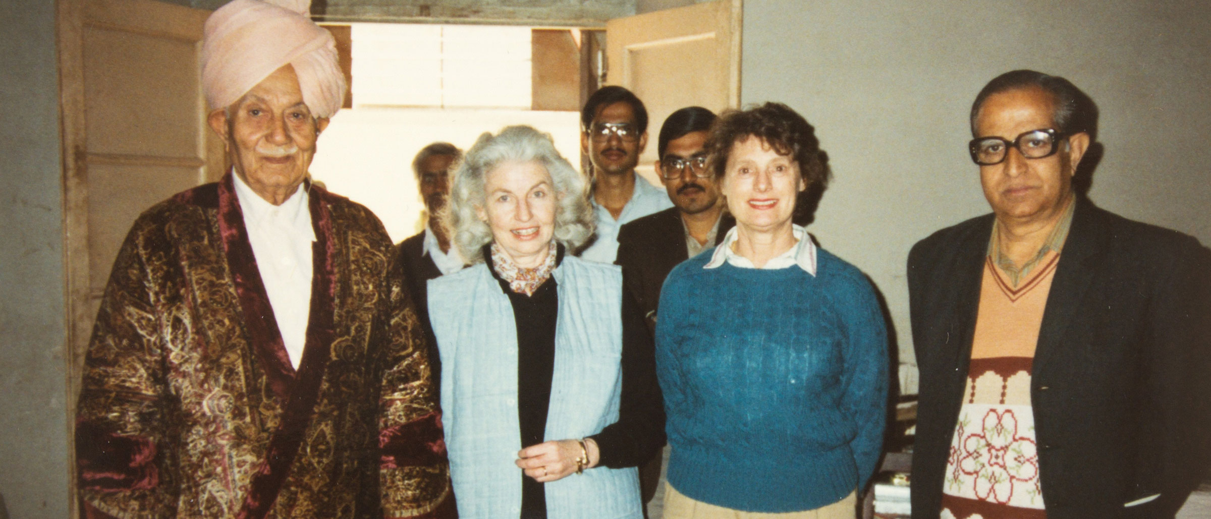 The author posing for a photograph with colleagues.