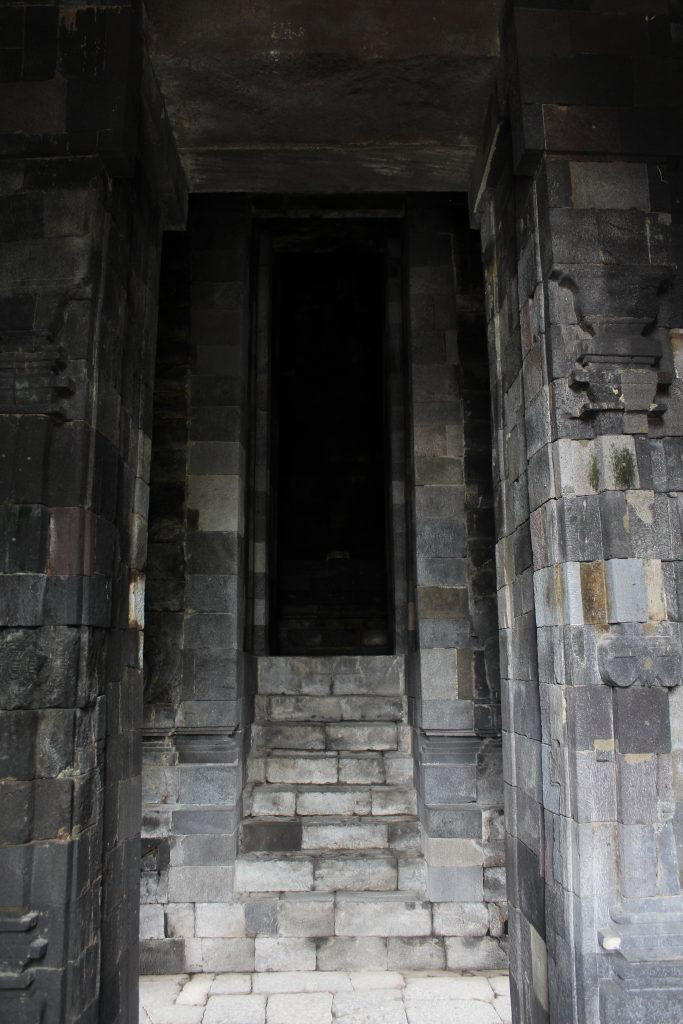 Staircase leading up to dark shrine interior