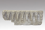 Fragment of a frieze carved with ibex heads
