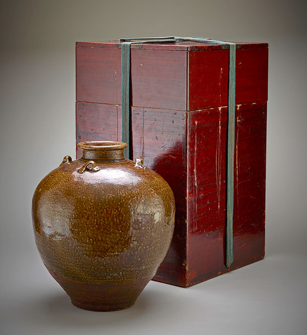 Brown tea jar wth red lacquer box, held shut by pale teal cord.