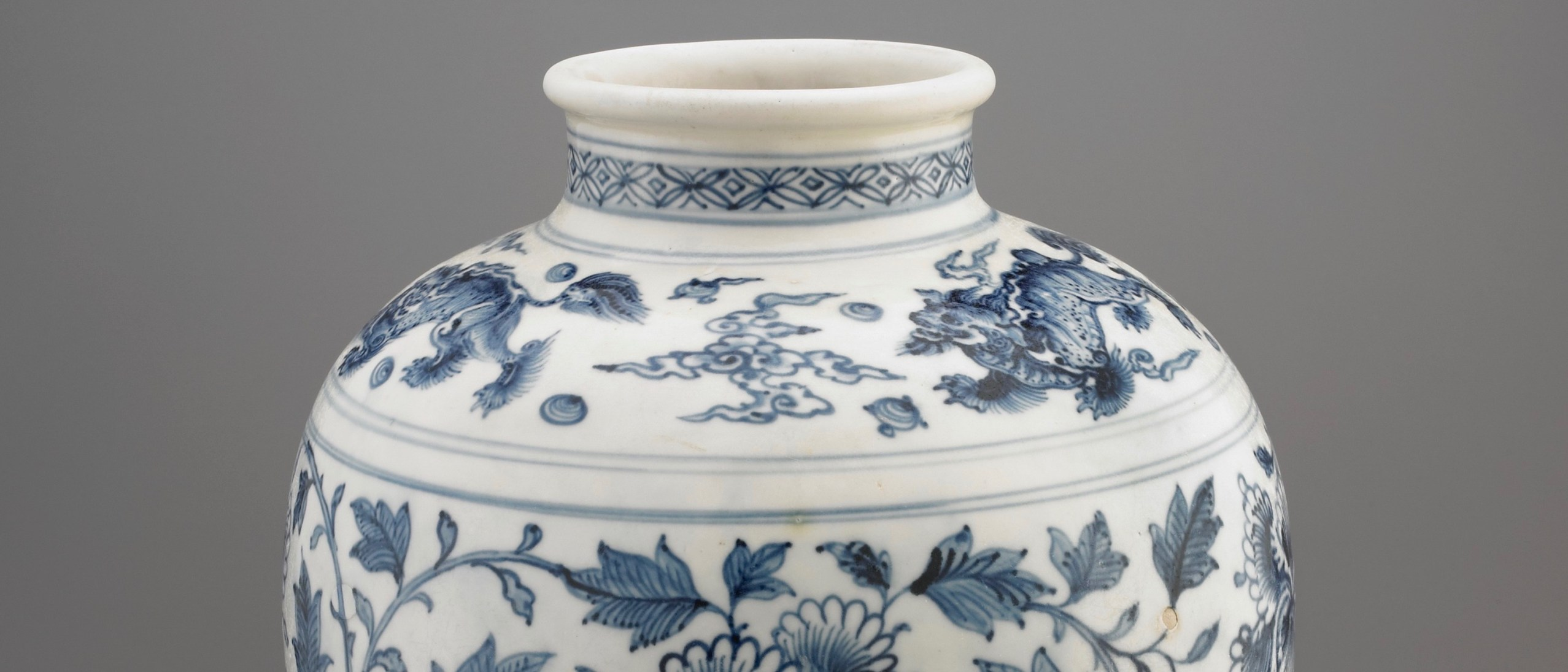 White stone jar decorated with flowers and mythical beasts, painted with cobalt (blue) pigment