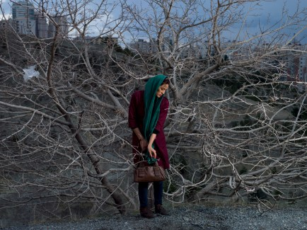 woman in the middle wearing turban in front of tree