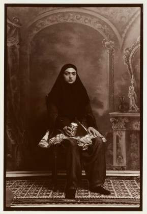 a woman with black turban sitting