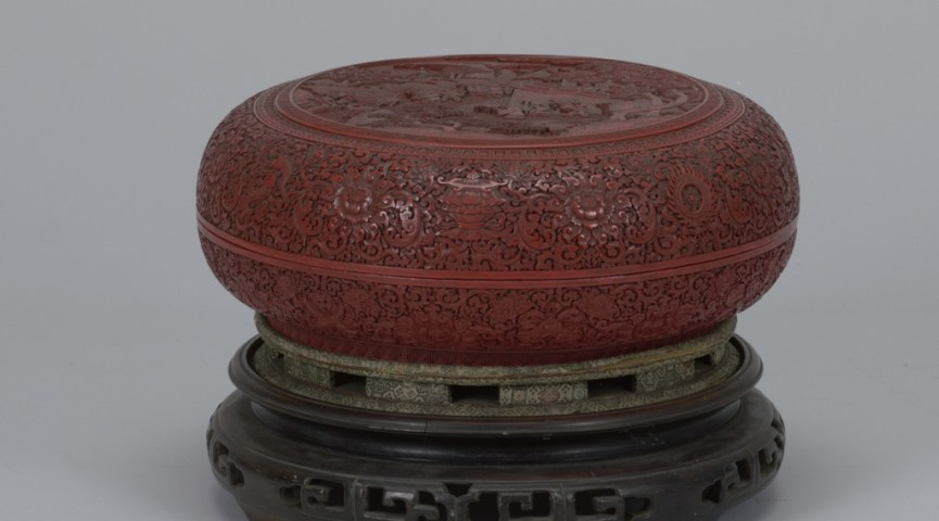 round red carved jar with lid