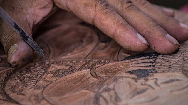 photo detail of a man's hand painting