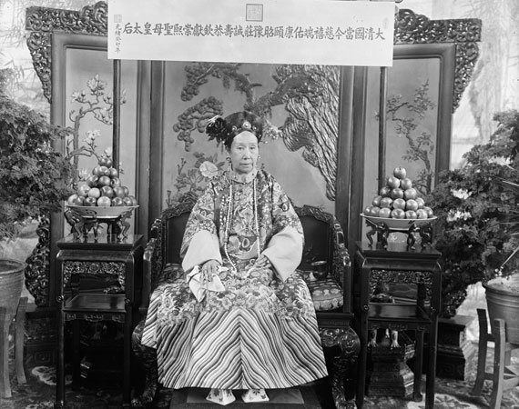 photo of a woman sitting dressed in traditional chinese attire