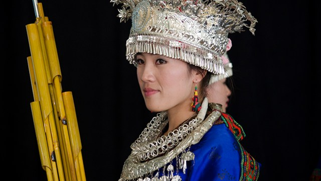 a women dressed in traditional Chinese attire including head dress