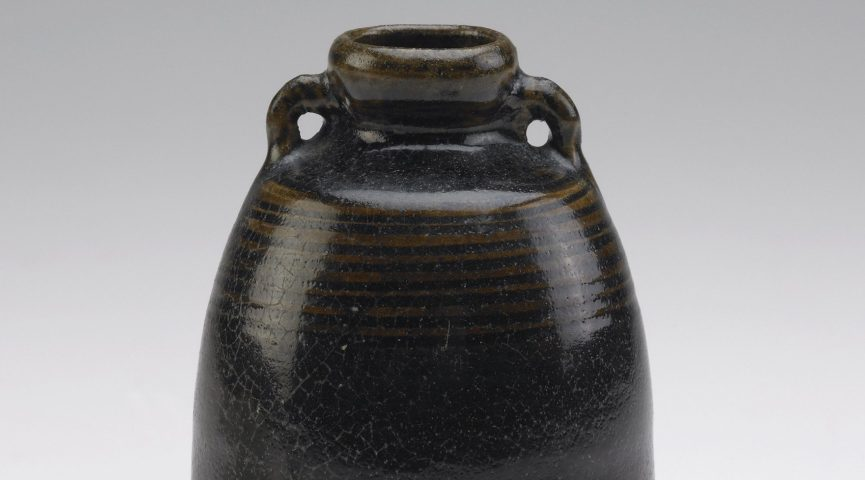 close up of an iron glazed vessel