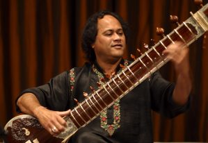 Krishna Mohan Bhatt performs on sitar at the Freer Gallery in 2003.