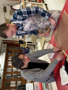 A conservator training a younger conservator.