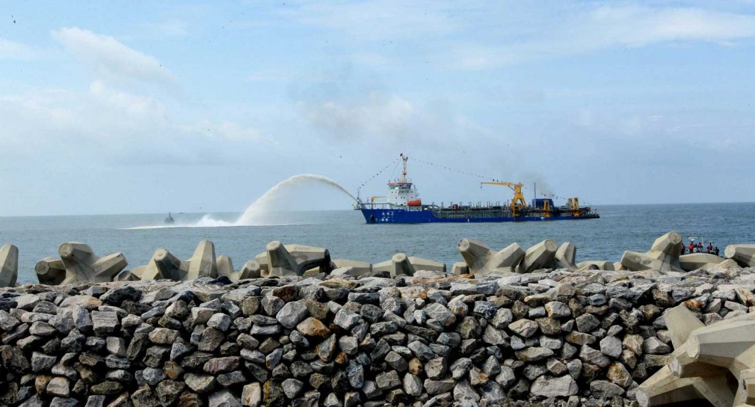 """Marine sand is pumped by a ship at the commencement of """"Colombo Port City"""" backed by China in Sri Lanka. Increasing attention is being paid to the social and environmental impacts of China's investments abroad."""
