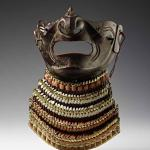 Face guard, steel, lacquer, gilding & textiles, Japan.Stanford Museum Collections