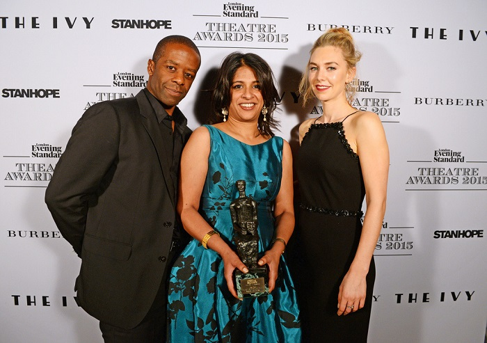 "LONDON, ENGLAND - NOVEMBER 22:  Indhu Rubasingham (C), accepting the Best Play award for ""The Motherf**ker in the Hat"", poses with presenters Adrian Lester (L) and Vanessa Kirby in front of the Winners Boards at The London Evening Standard Theatre Awards in partnership with The Ivy at The Old Vic Theatre on November 22, 2015 in London, England.  Pic Credit: Dave Benett"