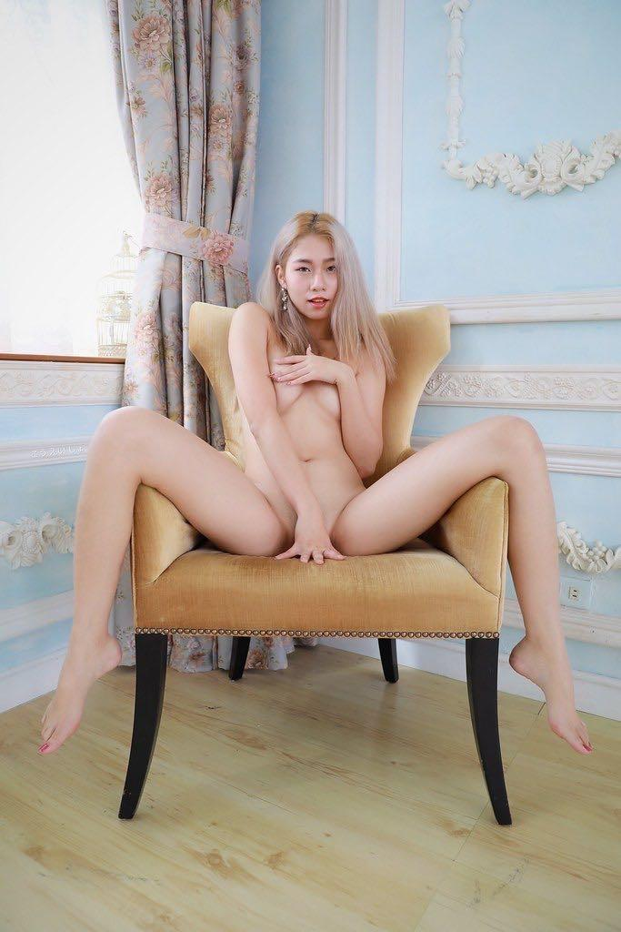 Blonde asian spreading legs