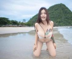 Big tits beach girl
