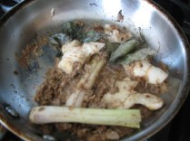 fry the shallot/spice past in a pan in a little oil. After a few minutes, add the lemongrass and galangal. If the mixture starts sticking or almost burning, simply take some of that soup broth and toss it in. Season with salt too.