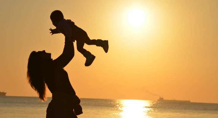 Mother-Baby-Holding-Beach-Sunset-Ocean