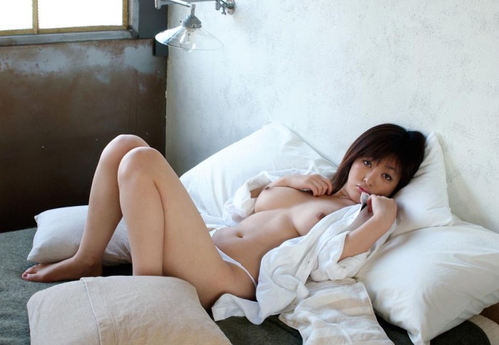 Lovely asian is undressing at home