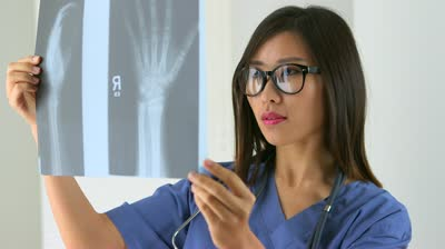 stock-footage-chinese-doctor-looking-at-x-ray