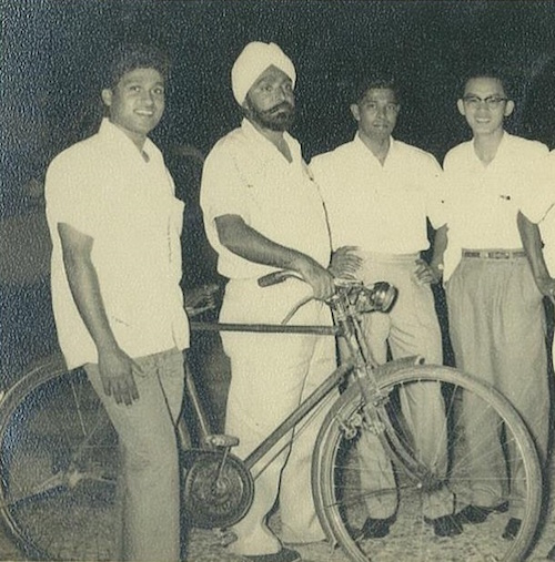 Late N. Gurdial Singh Gill with his fellow teacher friends and trusted bicycle. -- PHOTO COURTESY OF MALKEET