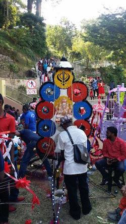 Kavadi decorated with a khanda.