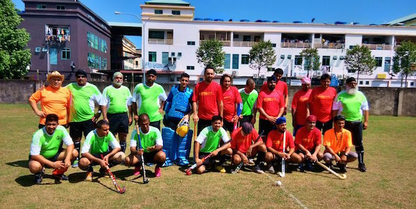 Miri (red) Kuching (green) prepare to battle it out in hockey at the 5th Borneo Sikh Games in Miri, Sarawak, on May 16.