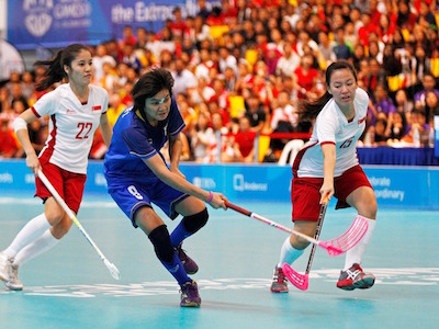 Women floorball: Singapore's Mohamed Zabir Fariza in action with Thailand's Duangporn Thararat. Singapore won the penalty shootout over Thailand after the teams played out a thrilling 3-3 draw. - PHOTO COURTESY OF SEAGAMES2015.COM/SINGSOC