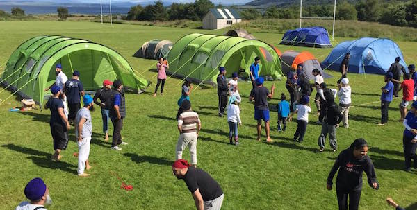 Pitching tents for the maiden SGGS Academy family camp in Scotland. - PHOTO SGGS ACADEMY