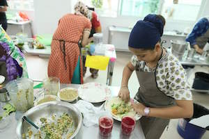 Khalsa Chef participants in action. - PHOTO / Sikh Sewaks Singapore Facebook