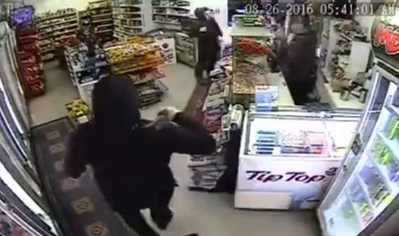 A footage showing a Sikh father-son shopkeepers taking on two armed robbers - PHOTO / ASIA SAMACHAR
