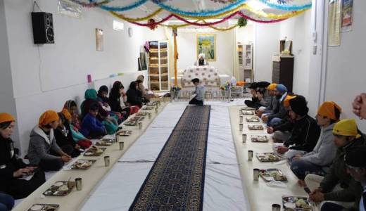 Group meals like this one at the Tokyo gurdwara, served for free to all attendees no matter their faith, are an important feature of Sikhism. | MEGHA WADHWA / Japan Times