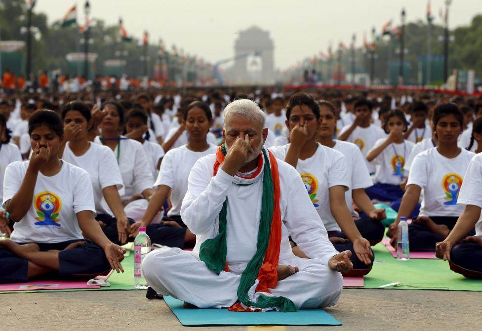 Prime Minister Narendra Modi performs yoga. He will be under pressure after the Kairana election loss -- AFP