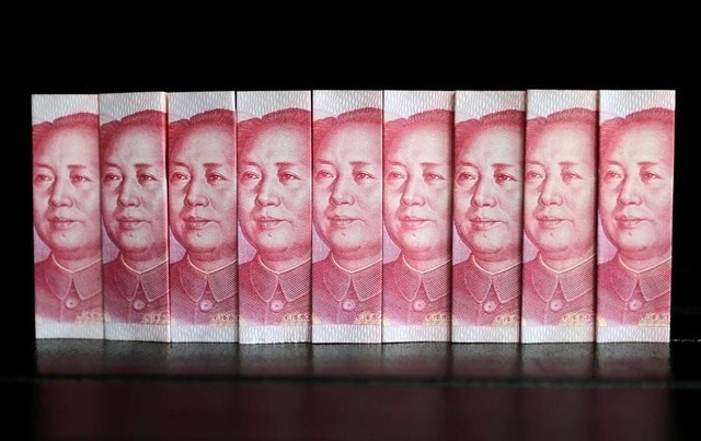 Chinese 100 yuan banknotes. Photo: Reuters