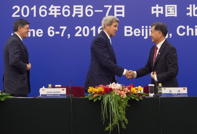 Former US Secretary of State John Kerry shakes hands with Chinese Vice Premier Wang Yang during the US - China Strategic and Economic Dialogue in Beijing. Photo: Saul Loeb