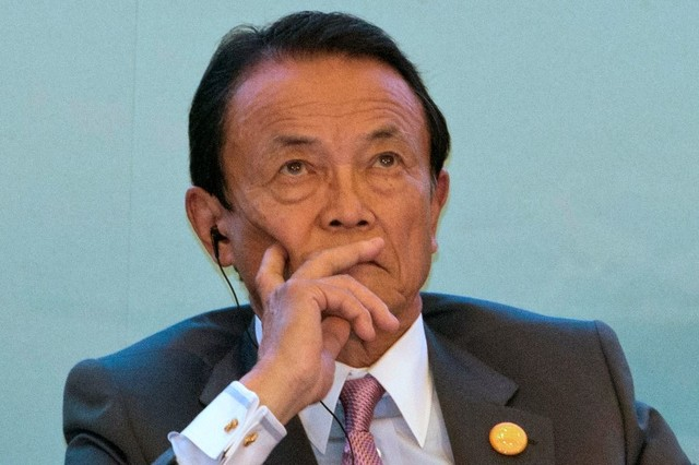 Taro Aso, Japan's Deputy Prime Minister, does it again. Photo: Reuters/Ng Han Guan