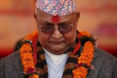 Nepal's Prime Minister Khadga Prasad Sharma Oli, also known as KP Oli, observes a minute of silence for earthquake victims, in Bungamati village