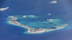 Chinese dredging vessels are purportedly seen in the waters around Mischief Reef in the disputed Spratly Islands in the South China Sea in this still image from video taken by a P-8A Poseidon surveillance aircraft. provided by the United States Navy May 21, 2015.  U.S. Navy/Handout via Reuters/File Photo
