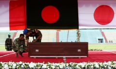 Army personnel adjust a coffin of a victim who was killed in the attack on the Holey Artisan Bakery and the O'Kitchen Restaurant, during a memorial ceremony in Dhaka