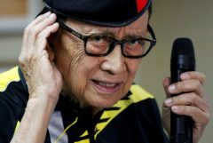 ormer Philippine President Fidel Ramos gestures as he speaks to journalists during a trip to Hong Kong