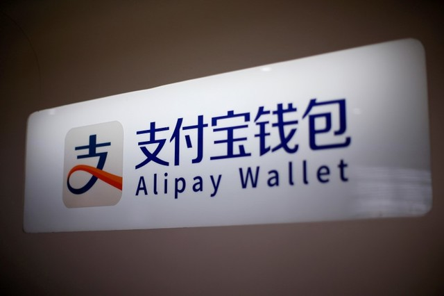 An Alipay logo is seen at a train station in Shanghai, China February 9, 2015. Photo: Reuters/Aly Song