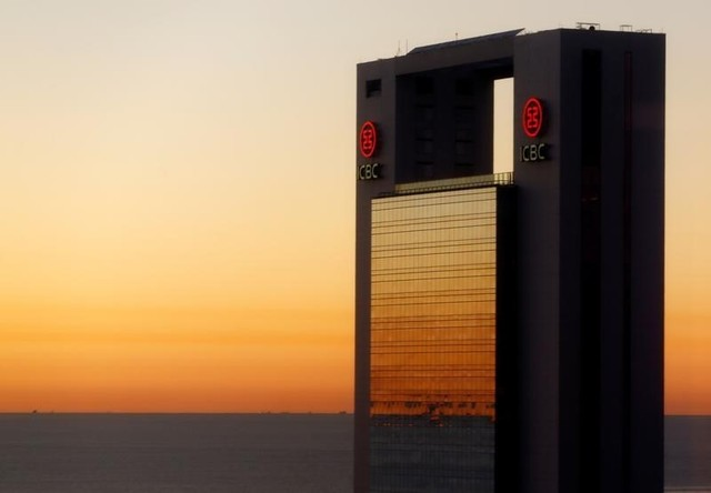 The Industrial and Commercial Bank of China Ltd (ICBC) logo is seen on a building at sunrise. Photo: Reuters/Enrique Marcarian