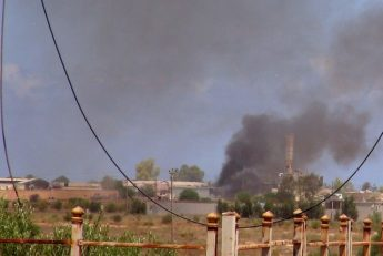Smoke rises following an air strike as Libyan forces allied with the U.N.-backed government battle with IS fighters to capture university buildings in Sirte